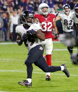 Ravens running back Justin Forsett rushed for his second touchdown of the season against the Cardinals (AP/Photo Ross D. Franklin)