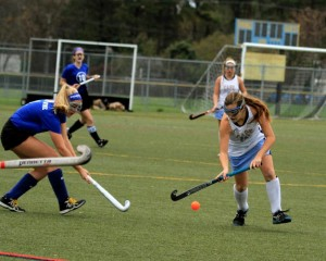Erin Coverdale (#16) Takes control of the ball (Photo: Eric Gooch).