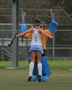 Lizzie Frederick (#1) and Riley Shields (goalie) chest bump after another score (Photo: Eric Gooch).