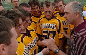 Salisbury University men's lacrosse Head Coach Jim Berkman, right, is shown giving a pep talk to his team. (Photo credit: Salisbury University)