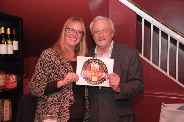 Ann McGinnis Hillyer of Shore Craft Beer and Sen. Jim Mathias show off the logo the State of Maryland will use to promote Febrewary: Maryland Craft Beer Lovers Month. (Courtesy: Shore Craft Beer)