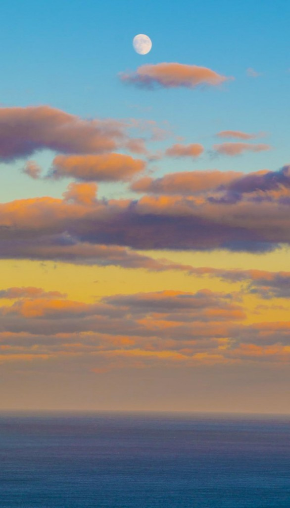 Sometimes-we-forget-that-we-can-see-the-moon-much-earlier-with-the-time-change-a-look-into-the-Atlantic-Ocean-at-sunset-586x1024