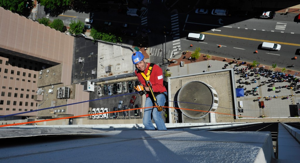 Fundraisers Rappel 17 Stories for Special Olympics Delaware