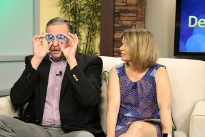 Jimmy tries on the goggles