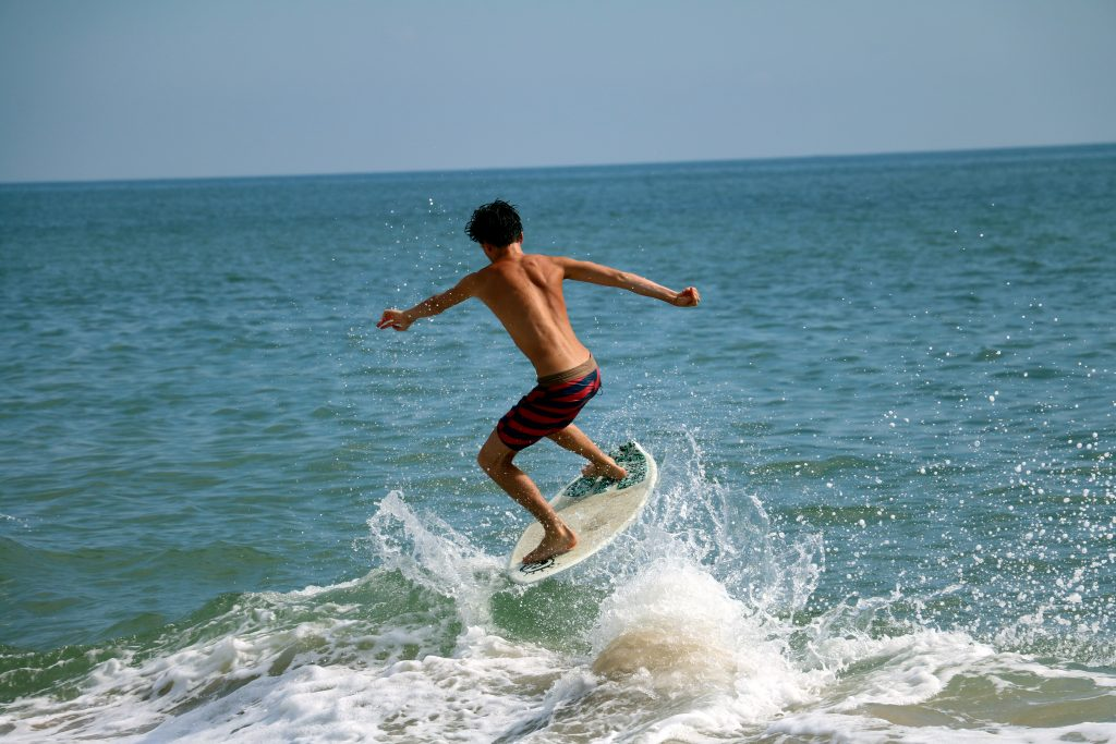 Carter Hill catches a wave in Dewey Beach (Photo: Lauren Holloway)