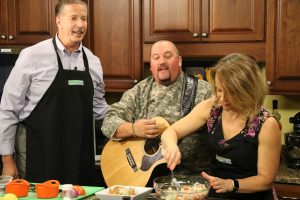 Chef Johnny Mo with Mallard's at the Wharf, sings and plays guitar during our kitchen segment