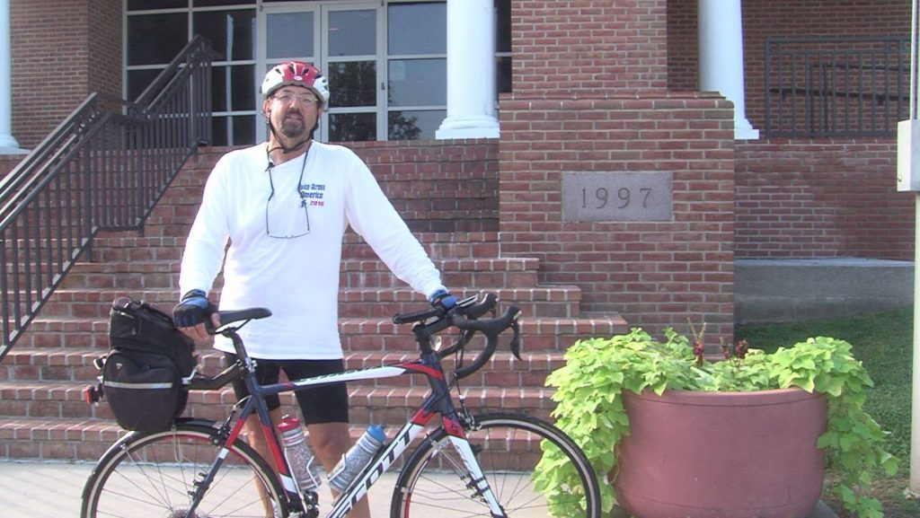Bill Morin stands outside of Dover Police Department on cross country ride (Photo: WBOC)