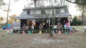 """A WBOC viewer wrote us, """"I retired after 37 years of teaching and could finally check this off my Bucket List: turned our log cabin into a gingerbread house for Christmas!"""""""