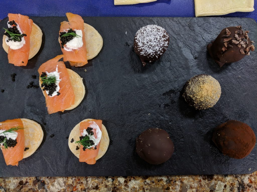 Bacon-Wrapped Dates, Apple and Brie Pastry Tarts, Salmon Blinis and Peanut Butter Truffles with Blue Moon