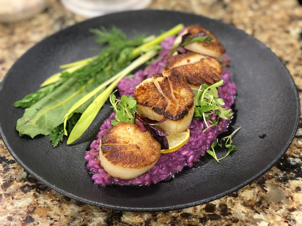 Tuna on a Salt Block and Scallops with Butterfly Pea Risotto, Arugula Oil, and Beet Butter with The Pines