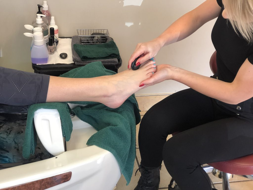 Paid Content by About Faces Day Spa and Salon: Using Hot Stones for Manicures and Pedicures