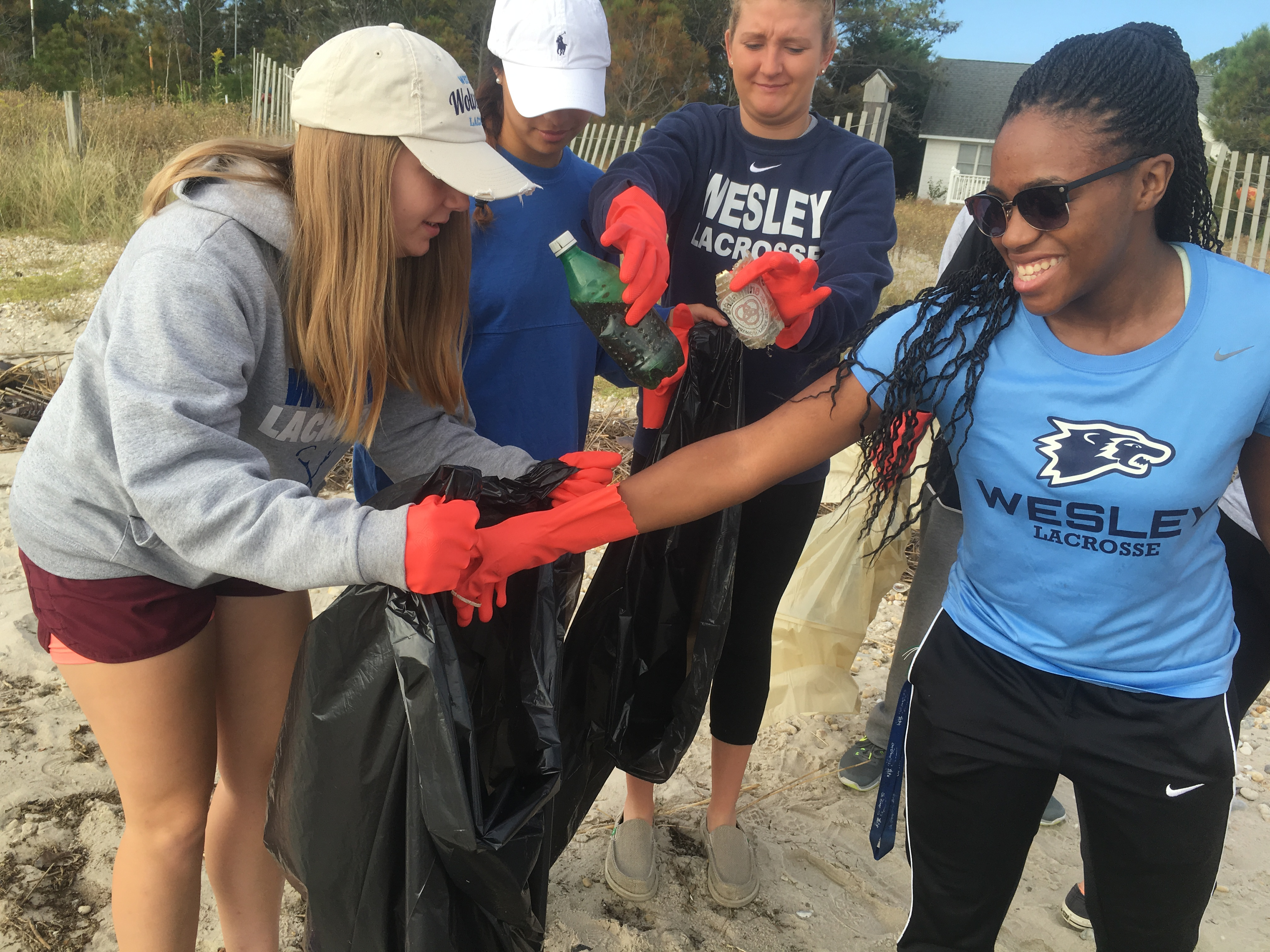 Wesley Women's LAX Continue Community Service Under New Head Coach
